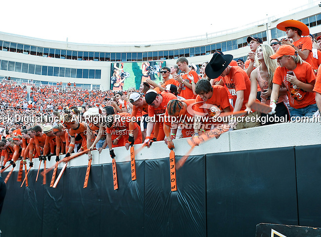 Oklahoma State students, the Cow Pokes, in action during the game between the Louisiana-Lafayette Ragin Cajuns and the Oklahoma State Cowboys at the Boone Pickens Stadium in Stillwater, OK. Oklahoma State defeats Louisiana-Lafayette 61 to 34.