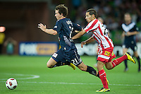 MELBOURNE, AUSTRALIA - DECEMBER 11: Robbie Kruse of the Victory and Adrian Zahra of the Heart compete for the ball during the round 18 A-League match between the Melbourne Heart and Melbourne Victory at AAMI Park on December 11, 2010 in Melbourne, Australia. (Photo by Sydney Low / Asterisk Images)