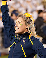 WVU cheerleader. The West Virginia Mountaineers defeated the Pittsburgh  Panthers 19-16 on November27, 2009 at Mountaineer Field at Milan Puskar Stadium, Morgantown, West Virginia.