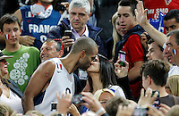 "France`s Tony Parker celebrate with French national basketball team suppoters and his girlfriend Axelle Francine after European basketball championship ""Eurobasket 2013""  final game between France and Lithuania in Stozice Arena in Ljubljana, Slovenia, on September 22. 2013. (credit: Pedja Milosavljevic  / thepedja@gmail.com / +381641260959)"