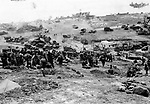 A U.S. medical detachment leaves its position on a hill overlooking the beach to follow advancing troops, during the Allied invasion of the Normandy, France, on June 20, 1944. (AP Photo/Irvin Bede)