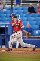 Fort Myers Miracle center fielder Aaron Whitefield (12) follows through on a swing during a game against the Dunedin Blue Jays on April 17, 2018 at Dunedin Stadium in Dunedin, Florida.  Dunedin defeated Fort Myers 5-2.  (Mike Janes/Four Seam Images)
