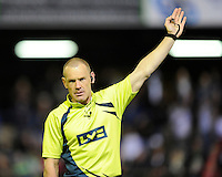 Referee Neil Hennessy blows for a penalty during the LV= Cup second round match between Ospreys and Northampton Saints at Riverside Hardware Brewery Field, Bridgend (Photo by Rob Munro)