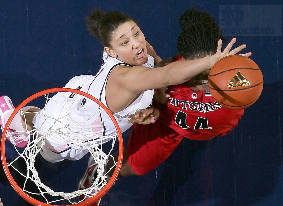 Feb. 12, 2011; Natalie Achonwa (11) knocks the ball away from Rutgers Scarlet Knights forward Monique Oliver (44) in the second half at the Purcell Pavilion. Notre Dame won 71-49.<br /> <br /> Photo by Matt Cashore