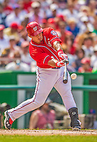 27 July 2013: Washington Nationals catcher Wilson Ramos connects against the New York Mets at Nationals Park in Washington, DC. The Nationals defeated the Mets 4-1. Mandatory Credit: Ed Wolfstein Photo *** RAW (NEF) Image File Available ***
