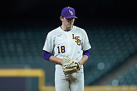 LSU Tigers starting pitcher Cole Henry (18) looks to his catcher for the sign against the Texas Longhorns in game three of the 2020 Shriners Hospitals for Children College Classic at Minute Maid Park on February 28, 2020 in Houston, Texas. The Tigers defeated the Longhorns 4-3. (Brian Westerholt/Four Seam Images)