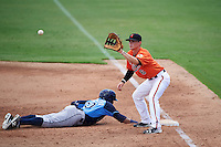 Baltimore Orioles first baseman Preston Palmeiro (6) waits for a throw as Eleardo Cabrera (60) dives back to first base during an Instructional League game against the Tampa Bay Rays on September 19, 2016 at Ed Smith Stadium in Sarasota, Florida.  (Mike Janes/Four Seam Images)
