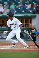 Tim Anderson (11) of the Chicago White Sox follows trough on his swing during a rehab assignment with the Charlotte Knights against the Buffalo Bisons at BB&T BallPark on July 24, 2019 in Charlotte, North Carolina. The Bisons defeated the Knights 8-4. (Brian Westerholt/Four Seam Images)