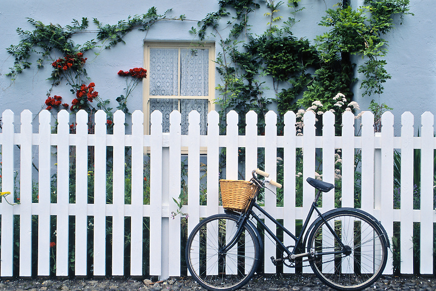 Bicycle, picket fence and cottage, County Kerry, Ireland