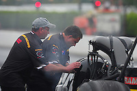 Nov. 10, 2011; Pomona, CA, USA; Crew members work on the car of NHRA top fuel dragster driver Cory McClenathan during qualifying at the Auto Club Finals at Auto Club Raceway at Pomona. Mandatory Credit: Mark J. Rebilas-.