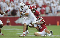 Arkansas linebacker Grant Morgan (31) stops Texas quarterback Hudson Card (1), Saturday, September 11, 2021 during the first quarter of a football game at Reynolds Razorback Stadium in Fayetteville. Check out nwaonline.com/210912Daily/ for today's photo gallery. <br /> (NWA Democrat-Gazette/Charlie Kaijo)