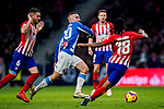 Sergi Darder Moll, S Darder, of RCD Espanyol (C) is tackled by Gelson Martins of Atletico de Madrid during the La Liga 2018-19 match between Atletico de Madrid and RCD Espanyol at Wanda Metropolitano on December 22 2018 in Madrid, Spain. Photo by Diego Souto / Power Sport Images