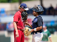Vero Beach Indians pitcher Jake Nolan (17) and Westminster Christian Warriors catcher Jayden Melendez (14) during the 42nd Annual FACA All-Star Baseball Classic on June 6, 2021 at Joker Marchant Stadium in Lakeland, Florida.  (Mike Janes/Four Seam Images)
