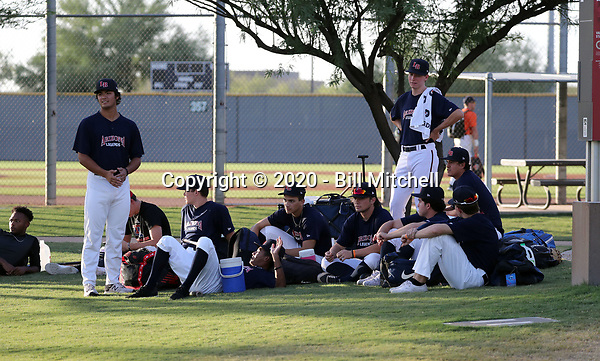 Legends Baseball team members wait for their game in the 2020 Arizona College Wood Bat League at Salt River Fields on July 2, 2020 in Scottsdale, Arizona (Bill Mitchell)