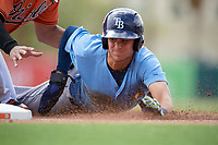 Tampa Bay Rays Josh Lowe (18) slides safely into third base during an Instructional League game against the Baltimore Orioles on October 2, 2017 at Ed Smith Stadium in Sarasota, Florida.  (Mike Janes/Four Seam Images)
