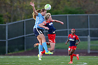 Piscataway, NJ, April 24, 2016.  Ashley Nick (10) of Sky Blue FC and Joanna Lohman (15) of the Washington Spirit vie for a header.  The Washington Spirit defeated Sky Blue FC 2-1 during a National Women's Soccer League (NWSL) match at Yurcak Field.