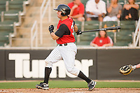 Kevin Dubler #35 of the Kannapolis Intimidators follows through on his swing against the Delmarva Shorebirds at Fieldcrest Cannon Stadium May 14, 2010, in Kannapolis, North Carolina.  Photo by Brian Westerholt / Four Seam Images