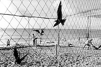 Republic of Nauru. Central Pacific. Nauru is a tiny island (21 square-km). The frigate bird is Nauru's national symbol. Men, as part as an antique custom, catch a flying frigate bird by throwing a lested rope in the air. Caged birds are excited by young men to fly in order to attract new birds. The goal is to cage as many as 31 birds and to achieve the highest honor in the community.  © 1999 Didier Ruef