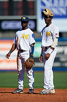 Michigan Wolverines second baseman Ako Thomas (4) and right fielder Christan Bullock (5) during a game against Army West Point on February 18, 2018 at Tradition Field in St. Lucie, Florida.  Michigan defeated Army 7-3.  (Mike Janes/Four Seam Images)