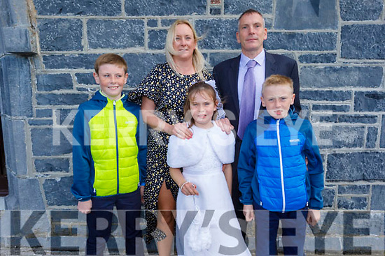 Muireann Wiseman, Ardfert NS student receiving her First Holy Communion in Ardfert on Saturday. L to r: Eamon, Antoinette, Kevin and Eoghan Wiseman.