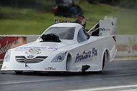 May 20, 2011; Topeka, KS, USA: NHRA funny car driver Melanie Troxel during qualifying for the Summer Nationals at Heartland Park Topeka. Mandatory Credit: Mark J. Rebilas-