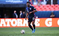 DENVER, CO - JUNE 3: Mark McKenzie #15 of the United States moves towards the box during a game between Honduras and USMNT at EMPOWER FIELD AT MILE HIGH on June 3, 2021 in Denver, Colorado.