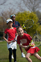 Kung Phimlee (centre) and Iman Garshong (back) during a training session with Dan Bloxham, Head Coach, at Wimbledon, The All England Lawn Tennis Club (AELTC), London...