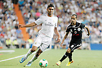 Real Madrid's Carlos Henrique Casemiro (l) and Al Sadd's Mesaad Ali Alhamad during Santiago Bernabeu Trophy.August 22,2013. (ALTERPHOTOS/Acero)