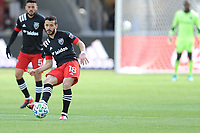 WASHINTON, DC - FEBRUARY 29: Washington, D.C. - February 29, 2020: Felipe Martins #18 of D.C. United moves the ball during a game between D.C. United and the Colorado Rapids. The Colorado Rapids defeated D.C. United 2-1 during their Major League Soccer (MLS)  match at Audi Field during a game between Colorado Rapids and D.C. United at Audi FIeld on February 29, 2020 in Washinton, DC.