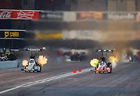 Feb 11, 2017; Pomona, CA, USA; NHRA top fuel driver Antron Brown (left) races alongside Doug Kalitta during qualifying for the Winternationals at Auto Club Raceway at Pomona. Mandatory Credit: Mark J. Rebilas-USA TODAY Sports