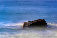 Rock with moving ocean water.