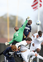 Bright Dike #9 and Dillon Powers #22 of the University of Notre Dame lose out to a high cross to Josh Ford #18 and Kwame Watson-Siriboe #4 of the University of Connecticut during a Big East match at Alumni Stadium on October 31 2009 in Notre Dame, Indiana. The Irish won 2-1.