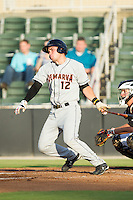 Austin Wynns (12) of the Delmarva Shorebirds follows through on his swing against the Kannapolis Intimidators at CMC-NorthEast Stadium on July 1, 2014 in Kannapolis, North Carolina.  The Intimidators defeated the Shorebirds 5-2. (Brian Westerholt/Four Seam Images)