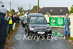 Killarney Celtic players and supporters give a guard of honour for former player Derek Twomey as his coffin passes Celtic Park on Monday