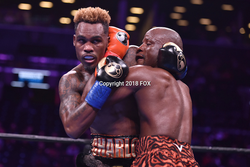 """BROOKLYN, NY - DECEMBER 22: (L-R) Jermell Charlo fightss Tony Harrison during their WBC Super Welterweight Championship bout at the Fox Sports and Premier Boxing Champions  December 22 """"PBC on Fox"""" Fight Night at the Barclays Center on December 22, 2018 in Brooklyn, New York. (Photo by Anthony Behar/Fox Sports/PictureGroup)"""