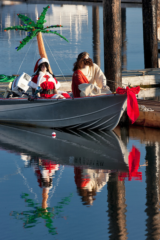 Comical boat with Christmas figures fishing. Bandon Harbor, OR