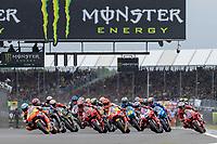 29th August 2021; Silverstone Circuit, Silverstone, Northamptonshire, England; MotoGP British Grand Prix, Race Day; Repsol Honda Team rider Pol Espargaro on his Honda RC213V leads the pack into the first corner
