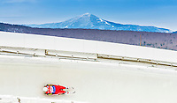 5 December 2014: Reinhard Egger, sliding for Austria, slides through Curve Number 14 on his first run, ending the day with a 13th place finish and a combined 2-run time of 1:43.706 in the Men's Competition at the Viessmann Luge World Cup, at the Olympic Sports Track in Lake Placid, New York, USA. Mandatory Credit: Ed Wolfstein Photo *** RAW (NEF) Image File Available ***