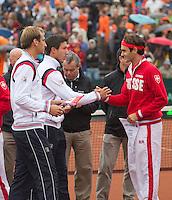 14-09-12, Netherlands, Amsterdam, Tennis, Daviscup Netherlands-Swiss,  Thiemo de Bakker(L) and  Igor Sijsling exchanging flags with Roger Federer(R)