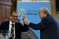 Secretary General of OECD Angel Gurria handing a glass of water to the Italian Minister of Economy Giovanni Tria<br /> Rome April 1st 2019. Presentation of the OECD Report on Italy 2019. The report says after a modest recovery, the Italian economy is weakening.<br /> photo di Samantha Zucchi/Insidefoto