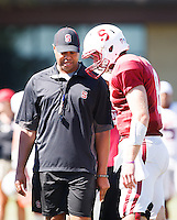STANFORD,CA-- August 24, 2013: David Shaw, head coach, and Kevin Hoganduring the open practice at the Dan Elliott Practice Field Saturday.<br /> <br /> It was part the Stanford Football 2013 Open House.
