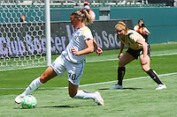 Camille Abily #20 of the Los Angeles Sol looks to control a loose ball against FC Gold Pride during their match at Home Depot Center on April 19, 2009 in Carson, California.