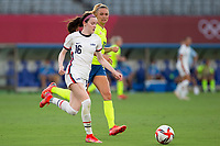 TOKYO, JAPAN - JULY 21: Rose Lavelle #16 of the United States attacking during a game between Sweden and USWNT at Tokyo Stadium on July 21, 2021 in Tokyo, Japan.