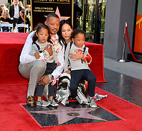 LOS ANGELES, USA. September 24, 2019: Terrence Howard & Mira Pak & children at Hollywood Walk of Fame Star Ceremony for actor Terrence Howard.<br /> Picture: Paul Smith/Featureflash