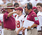 Florida State head coach Bobby Bowden (L) and offense coordinator and head-coach-in-waiting Jimbo Fisher have a disagreement in the first half of the Seminoles' 17-7 loss to the University of South Florida Bulls in Tallahassee, Florida September 26, 2009. (Mark Wallheiser/TallahasseeStock.com)