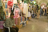 Tripoli, Libya - Street Scene in the Medina (Old City) Market (Suq).  Women's Clothing and Textiles Section.