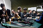 Young Chechen men visit the shooting gallery in the newly opened Grozny City shopping mall. Grozny, Chechnya, Russia, 2010