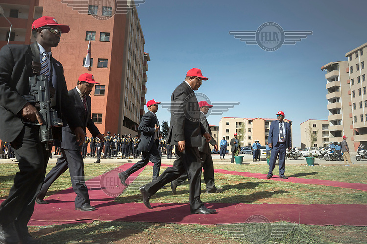 Armed security guards surround the Prime Minister, Hailemariam Desalegn, during the opening of an housing estate where the apartments are for low income households.