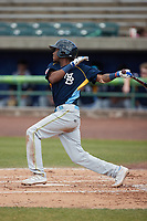 Yeison Santana (16) of the Myrtle Beach Pelicans follows through on his swing against the Lynchburg Hillcats at Bank of the James Stadium on May 23, 2021 in Lynchburg, Virginia. (Brian Westerholt/Four Seam Images)