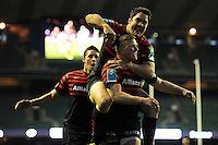 Chris Ashton of Saracens celebrates scoring a try with Brad Barritt (top) as Joel Tomkins looks on during the Heineken Cup quarter final match between Saracens and Ulster Rugby at Twickenham Stadium on Saturday 6th April 2013 (Photo by Rob Munro)